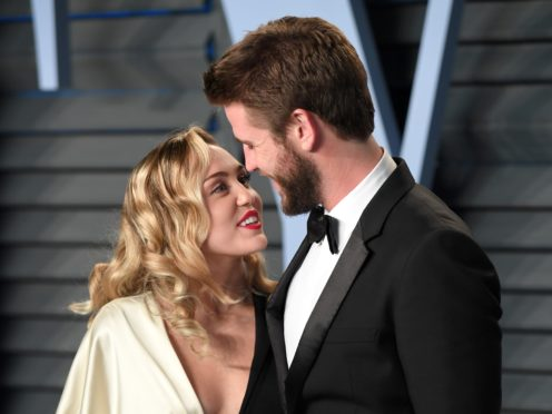 Miley Cyrus stepped in for husband Liam Hemsworth at the premiere of his latest film (PA)