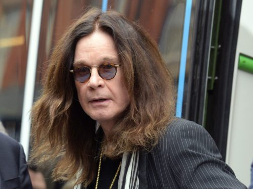 Ozzy Osbourne has been admitted to hospital after suffering from flu, wife Sharon has said (PA)
