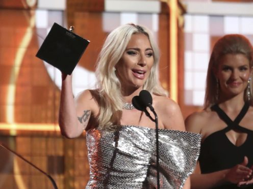 Lady Gaga reacts before accepting the award for best pop duo or group performance (Matt Sayles/Invision/AP)