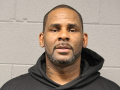 R&B singer R Kelly has been charged with aggravated sexual abuse (Chicago Police Dept via AP)