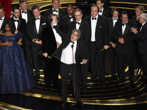 Peter Farrelly, centre, and the cast and crew of Green Book accept the award for best picture at the Oscars (Chris Pizzello/Invision/AP)