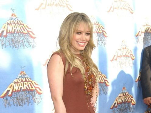 Fans were given a glimpse at Hilary Duff as Sharon Tate in a clip from an upcoming film (Anthony Harvey/PA)