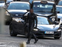 Actor Idris Elba during filming in Glasgow city centre for a new Fast and Furious franchise movie (Andrew Milligan/PA)