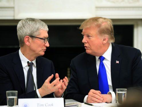 President Donald Trump talks to Apple boss Tim Cook during meeting in tt the White House (Manuel Balce Ceneta/AP)