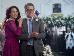 Andie MacDowell and Hugh Grant during the filming of One Red Nose Day and a Wedding (Comic Relief/PA)