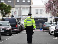 Police at the scene in Fulham, west London where a 29-year-old man was stabbed to death in the early hours of Saturday (PA)