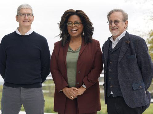 (From left to right) Apple CEO Tim Cook, Oprah Winfrey and Steven Spielberg pose for a photo outside the Steve Jobs Theater during an event to announce new Apple products (Tony Avelar/AP)