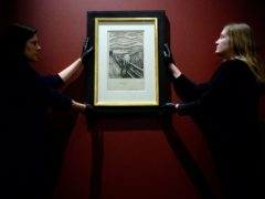 Gallery technicians install Edvard Munch's The Scream at the British Museum (Kirsty O'Connor/PA)
