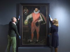 National Trust staff with the portrait of Sir Francis Drake (National Trust/PA)
