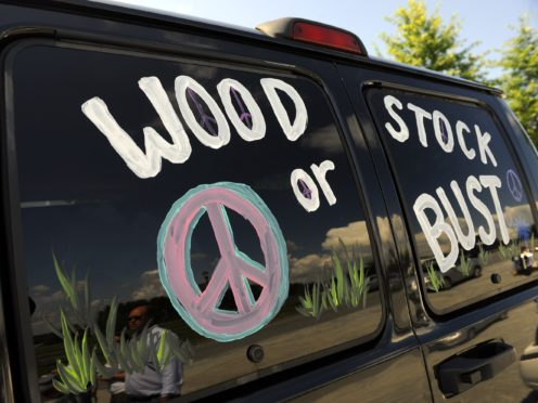 A van decorated with Woodstock or Bust at the original Woodstock Festival site in Bethel, New York (Stephen Chernin/AP)