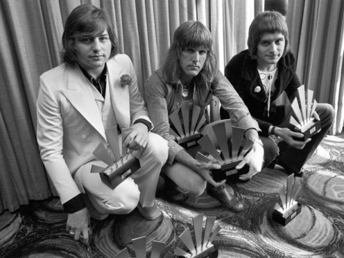 A Persian rug is among the items belonging to the late rock star Greg Lake (left) going under the hammer (PA)