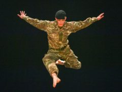 Trooper Alex Smith, of 1st The Queen's Dragoon Guards, leaps into the air during rehearsals for 10 Soldiers (Ben Birchall/PA)