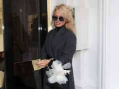 Pamela Anderson arriving to visit Julian Assange at the Ecuadorian embassy in London in 2017 (Jonathan Brady/PA)
