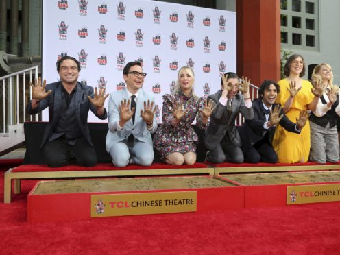 """Johnny Galecki, from left, Jim Parsons, Kaley Cuoco, Simon Helberg, Kunal Nayyar, Mayim Bialik and Melissa Rauch members of the cast of the TV series """"The Big Bang Theory,"""" show their hands after placing them in cement during a hand and footprint ceremony at the TCL Chinese Theatre on Wednesday, May 1, 2019 at in Los Angeles. (Photo by Willy Sanjuan/Invision/AP)"""