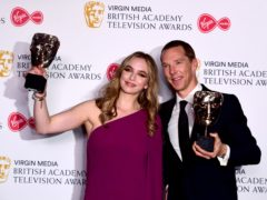 Jodie Comer and Benedict Cumberbatch show off their awards (Ian West/PA)