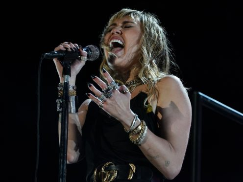 Miley Cyrus's new EP is titled She Is Coming (Owen Humphreys/PA)