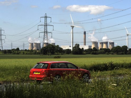 Net zero would require emissions to be eliminated from electricity and transport (John Giles/PA)
