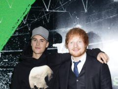 Justin Bieber and Ed Sheeran currently sit at number one (Yui Mok/PA)