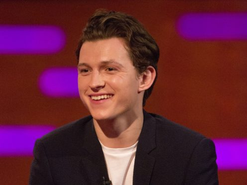Tom Holland plays Peter Parker and his Spider-Man alter ego (Isabel Infantes/PA)