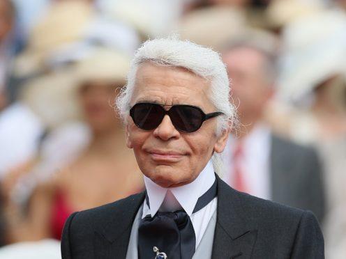A photograph of late German fashion designer Karl Lagerfeld is displayed (Francois Mori/AP)