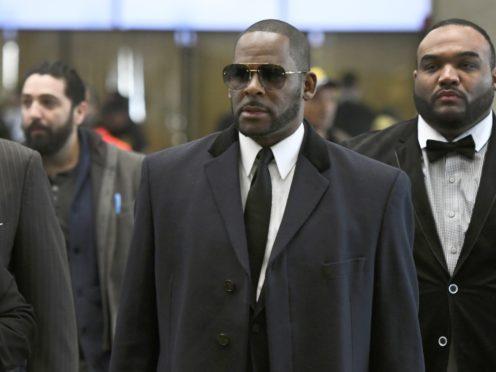 Musician R. Kelly, centre, arrives for a court hearing in Chicago (Matt Marton/AP)