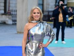 Kylie Minogue has admitted she will shed a tear on stage at Glastonbury 14 years after breast cancer deied her a headline slot (Ian West/PA)