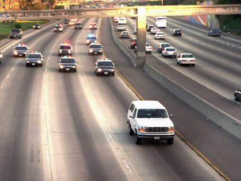 A white Ford Bronco, driven by Al Cowlings carrying OJ Simpson, is trailed by Los Angeles police cars as it travels on a road (JOseph R. Villarin/AP)