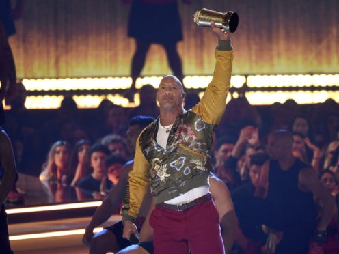 Dwayne 'The Rock' Johnson reflected on his early career in Hollywood as he was honoured with a lifetime achievement award (Chris Pizzello/Invision/AP)
