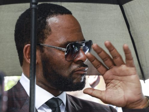 R Kelly leaves court after a hearing (AP Photo/Amr Alfiky)