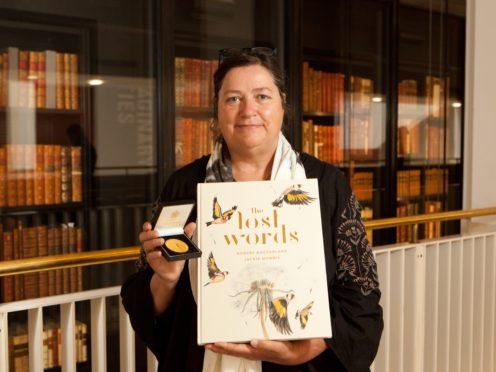Illustrator Jackie Morris with The Lost Words (Katariina Jarvinen/PA)
