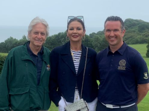 Michael Douglas, Catherine Zeta-Jones and golf club director Andrew Minty (Andrew Minty/Langland Bay Golf Club)