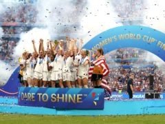 USA's Megan Rapinoe (centre) and team-mates celebrate with the FIFA Women's World Cup Trophy (PA)
