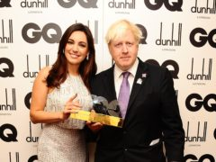 Kelly Brook with Boris Johnson at the 2012 GQ Men Of The Year Awards (Ian West/PA)