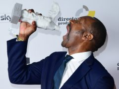 Sir Lenny Henry with the Outstanding Achievement Award (Ian West/PA)