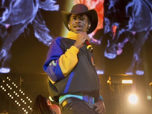 Lil Nas X has taken his Old Town Road to the top of the Billboard charts for 17 weeks, beating a record set by Mariah Carey (Scott Roth/Invision/AP)