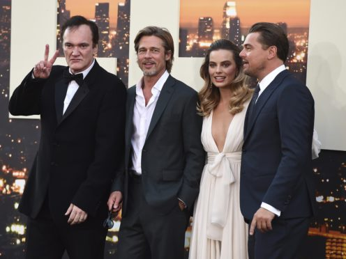 Quentin Tarantino poses with cast members Brad Pitt, Margot Robbie and Leonardo DiCaprio (Jordan Strauss/AP)