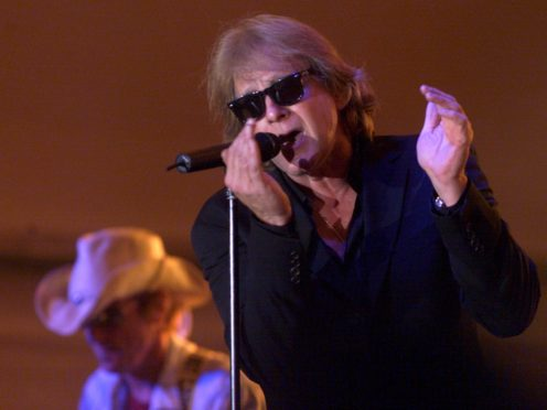 Eddie Money performs on stage (Jessica Reilly/Telegraph Herald/AP)