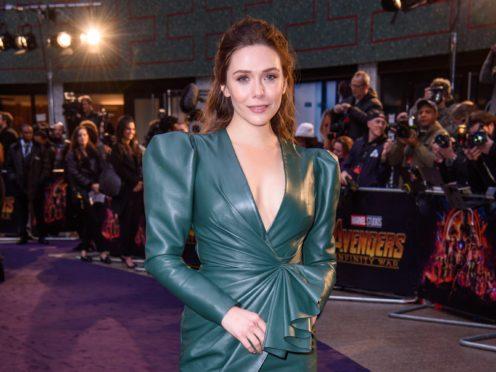 WandaVision star Elizabeth Olsen said she is 'really sad' at the prospect of Tom Holland's Spider-Man leaving the Marvel Cinematic Universe (Matt Crossick/PA)