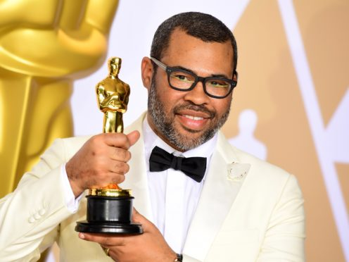 Jordan Peele with his Best Original Screenplay Oscar for Get Out (Ian West/PA)