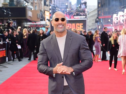 Dwayne 'The Rock' Johnson said Kevin Hart is 'doing very well' after he suffered back injuries in car crash (Ian West/PA)
