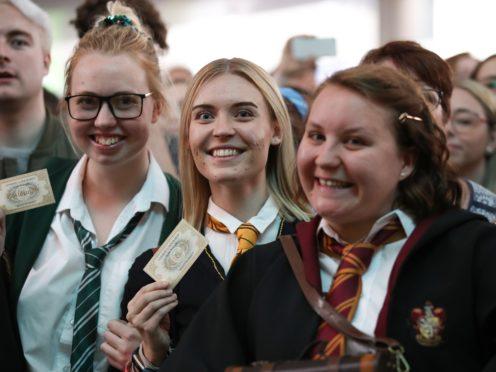 Harry Potter fans gather for Back to Hogwarts Day at London King's Cross station (Chris Radburn/PA)