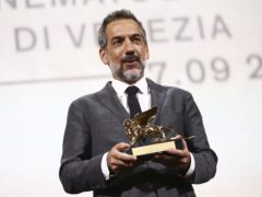 Todd Phillips holds the Golden Lion for Best Film for Joker (Joel C Ryan/Invision/AP)