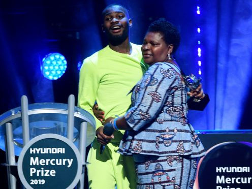 Dave hugs his mother after winning the Mercury Prize (Ian West/PA)