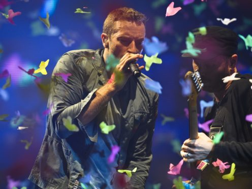 Chris Martin of Coldplay performs at Glastonbury (Ben Birchall/PA)
