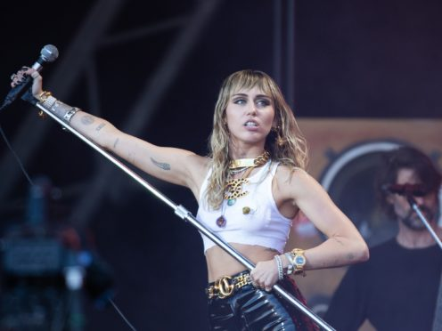 Miley Cyrus has been taken to hospital after complaining of tonsillitis (Aaron Chown/PA)