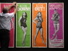 Prop Store poster consultant Mike Bloomfield adjusts US Door Panels for the 1965 James Bond film Thunderball (Andrew Matthews/PA)