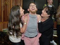 Winner Paddy Smyth, celebrates with his mother and sister, following the live final of the second series of Channel 4's The Circle, in Salford, Manchester. (Peter Powell/PA)