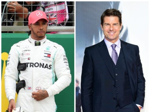 Lewis Hamilton and Tom Cruise (PA)