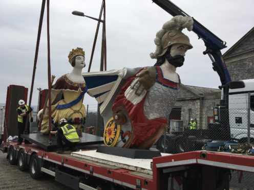 The HMS Windsor Castle and HMS Defiance figureheads leaving Plymouth (The Box/PA)