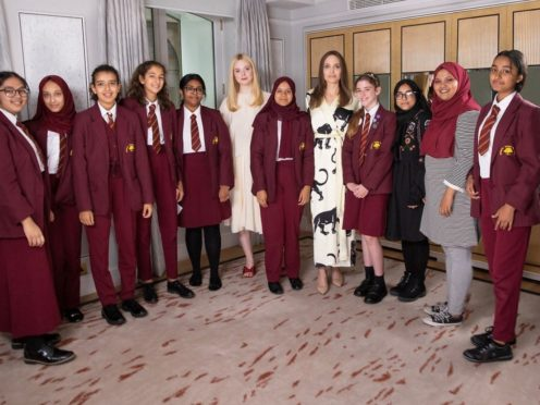 Angelina Jolie and Elle Fanning speak to girls from Mulberry School for Girls in Whitechapel, London (James Gillham/Disney/PA)